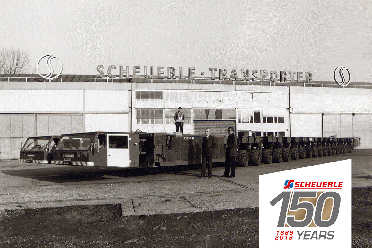 More than 30 years ago, the first SCHEUERLE SPMT has been developed and delivered to dutch transport company Mammoet. Ever since then, the SPMT wrote history in the field of heavy duty transport, globally. The gentleman second from left is Otto Rettenmaier, owner oft he company