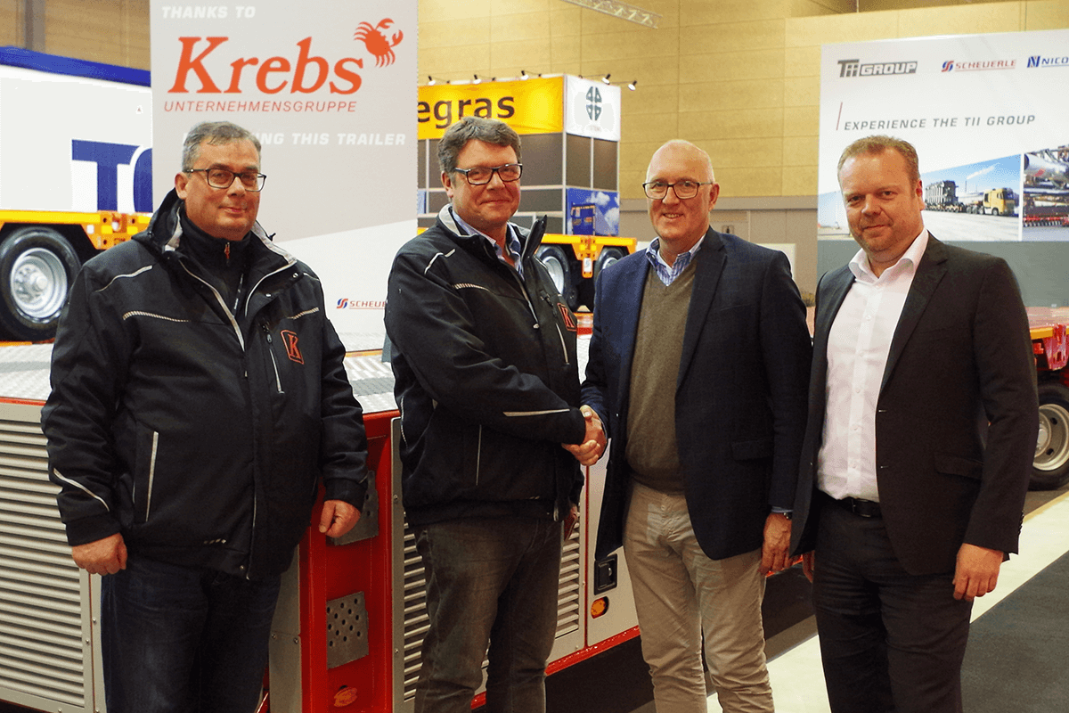 Detlef Krebs is delighted about the new addition to his fleet. With the 30 new InterCombi SPE self-propelled modules, the fleet of vehicles at the Krebs Group has now 90 axle lines from Scheuerle for transport operations at industrial companies and shipyards. The handover took place at Transport fair 2019 in Denmark. From left to right: Jörg Neuhäusel, Technical Director Krebs Group; Owner Detlef Krebs; Bernd Schwengsbier, President TII Sales and Markus Pflederer, Key Account Manager TII Sales
